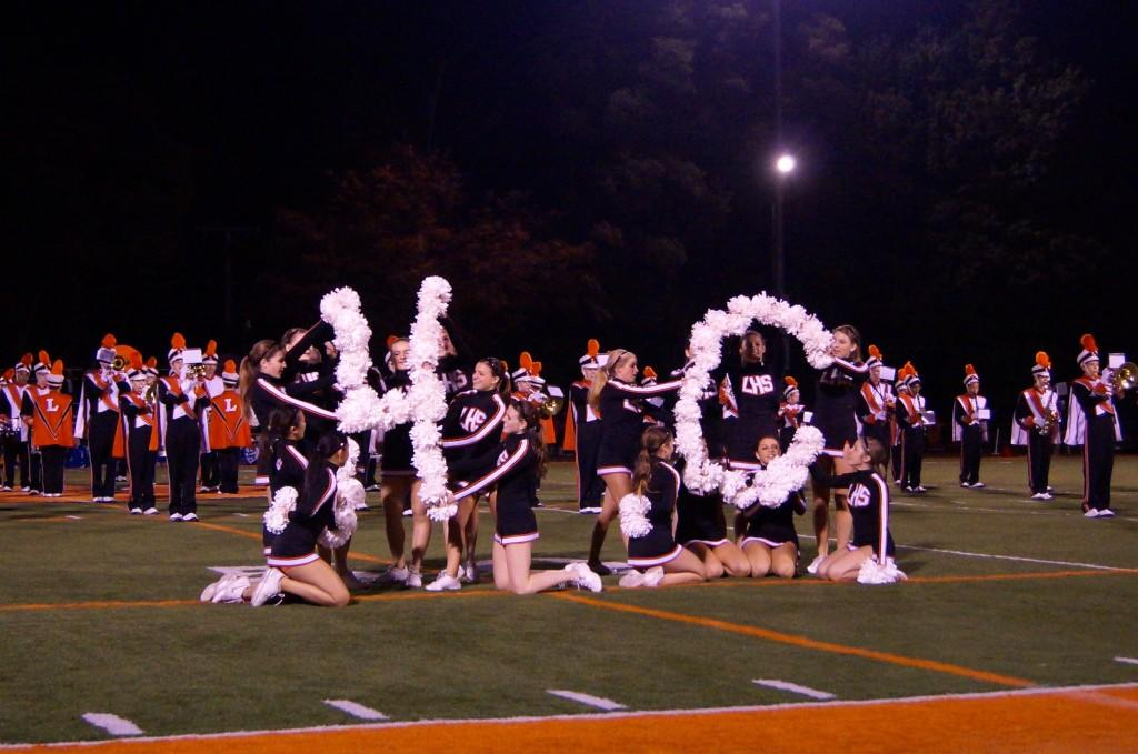 LHS+Poms+use+their+pom+poms+to+spell+out+%22HC%22+in+honor+of+the+Homecoming+game.