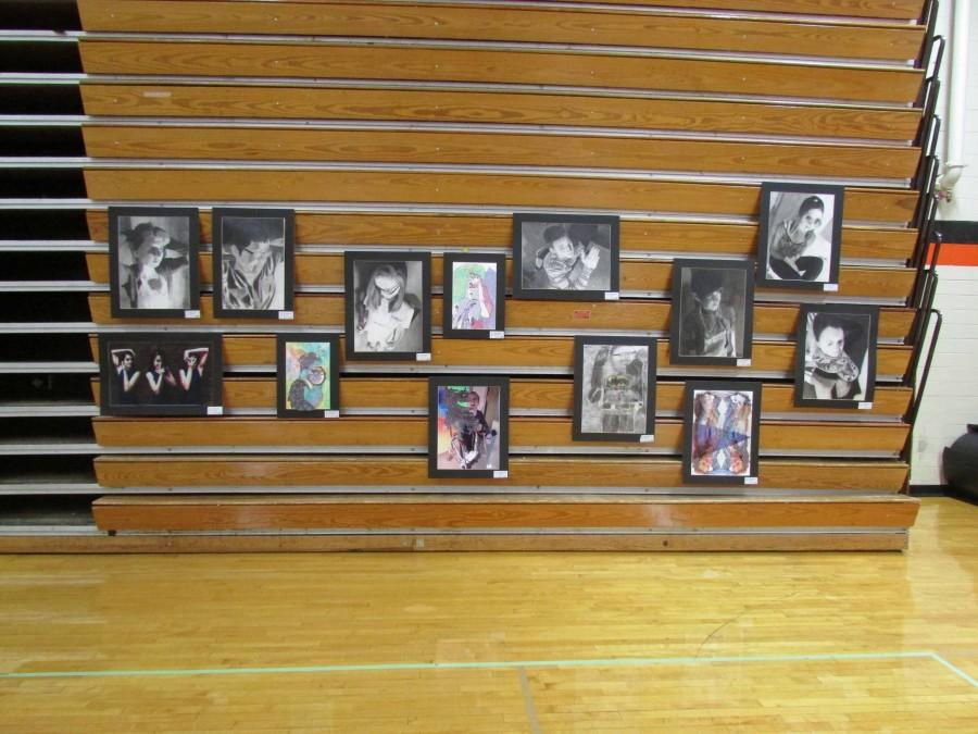 Many self portraits, including Emily Schuler's, were hung on the bleachers.