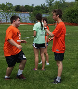 Junior Chris Derose and senior Trevor Fuhrman supporting each other with high fives.