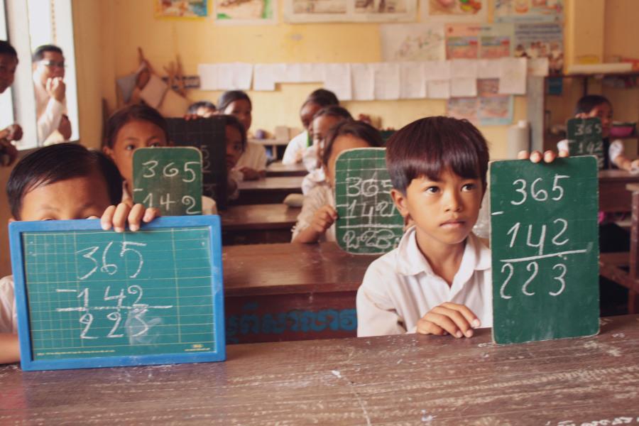 Cambodian school children participating in math class.