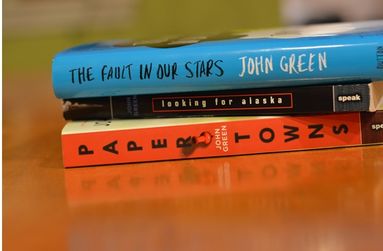 The Fault in Our Stars, Looking for Alaska, and Paper Towns are all books by John Green being adapted into  movies.