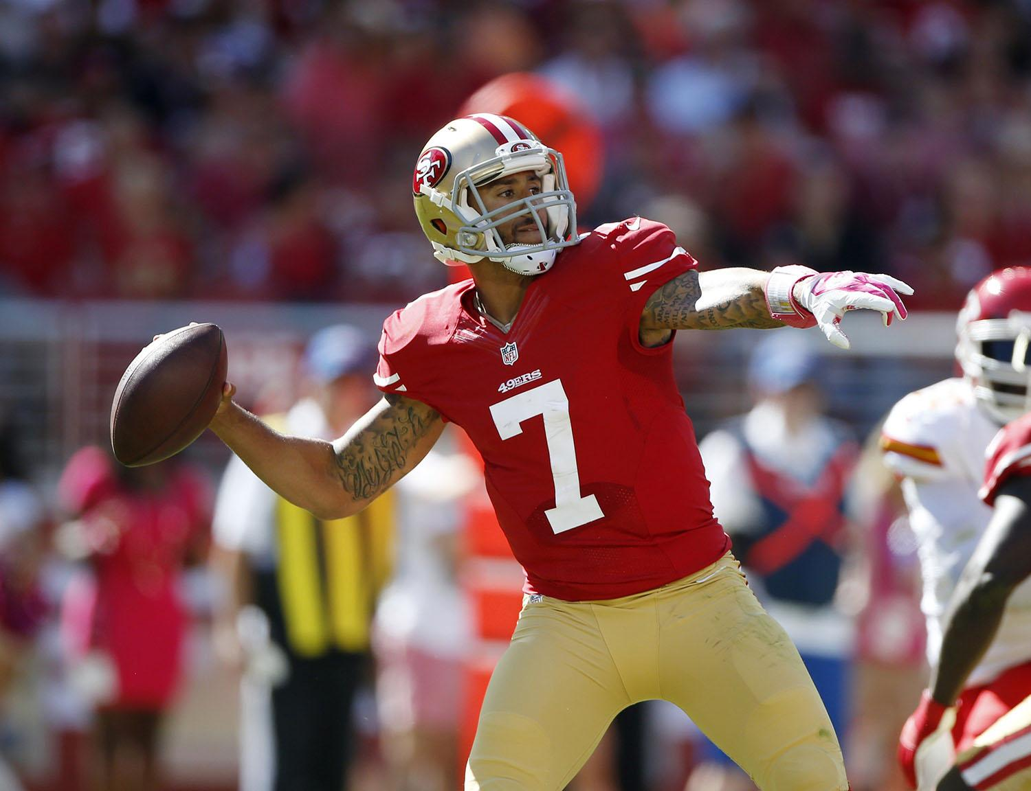 Colin+Kaepernick+should+utilize+both+his+legs+and+arm+as+he+tries+to+move+the+ball+against+a+tough+Seahawks+defense