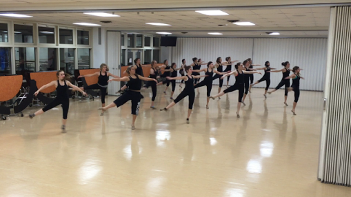 Varsity Poms prepares in the lunchroom for upcoming competition.