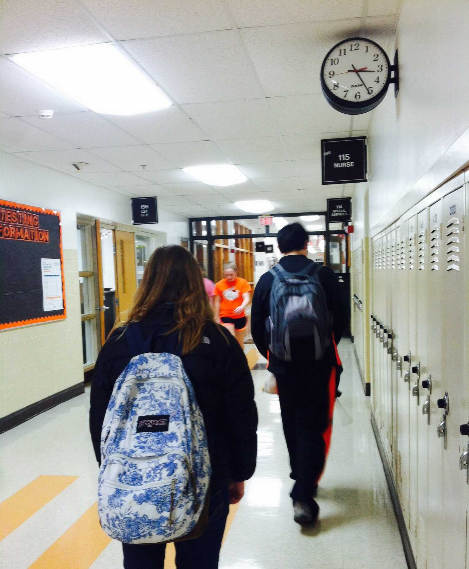 Freshman students Madeline Bartusch and Aaron Chen are seen walking in the hallways, similarly to how students would walk before hearing the music start playing in the halls.