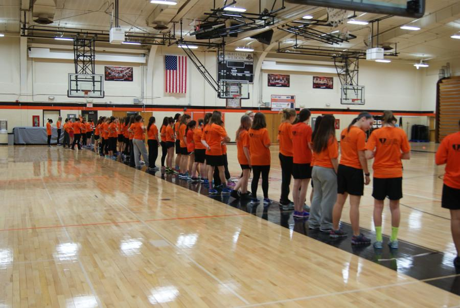 Freshman and sophomore gym classes are lined up to run the pacer test.
