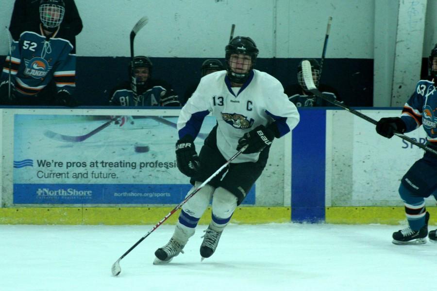 Alex Feinman, one of the Varsity IceCats' leading scorers, skates into play.