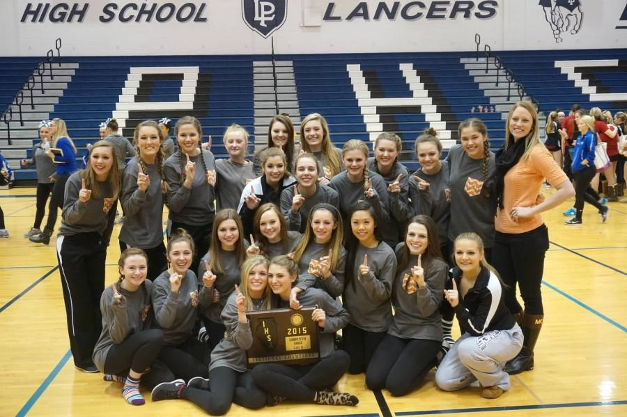 The+Varsity+Poms+team+poses+with+their+Sectional+Championship+Plaque.%0APhoto+courtesy+of+Emily+Yates
