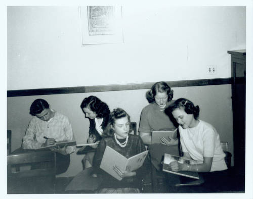 Students share and sign copies of the 1947 school yearbook, the Nautilus. From left to right are Don Berkley, Betty Carberry, unknown, Marilyn Covert and Joan Baker.