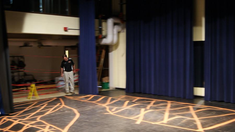 Security guard Mike Dolan acknowledges the ruined theater floor