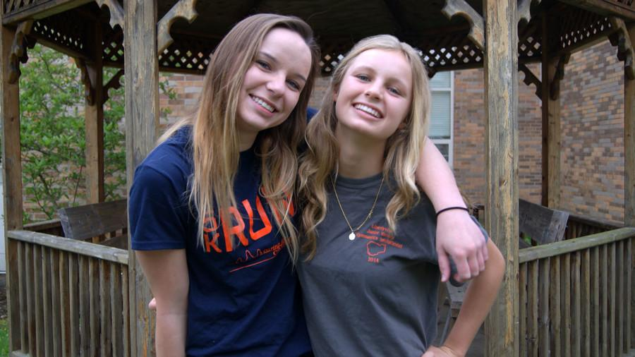 Sophomores Morgan Paul (left) and Taylor Underwood (right) proudly wear their Caring for Cambodia fundraiser shirts.