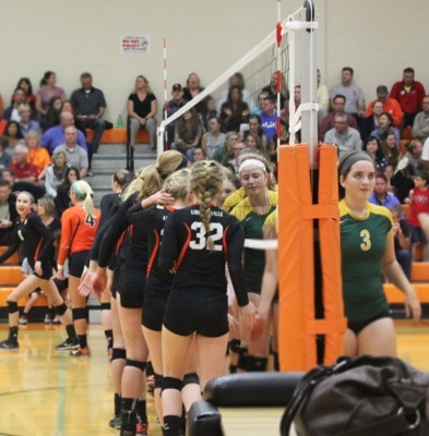 Volleyball teams from Libertyville and Stevenson line up at the net to wish each other good luck before the games.