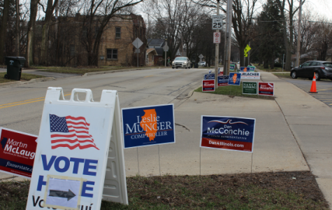 Campaign signs rest outside a local polling place, where voters are welcome to participate in the March 15 primary.