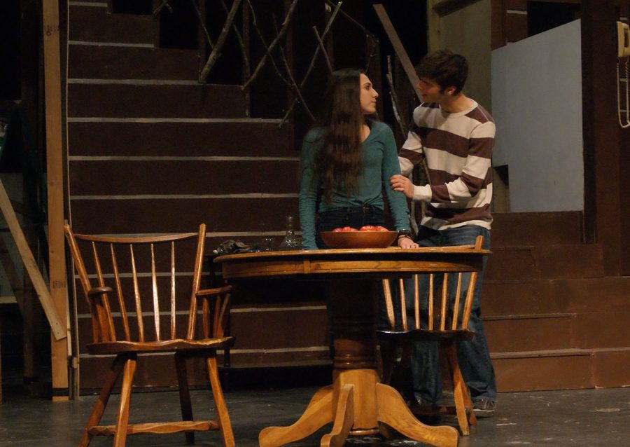 Senior Jackie Ovassapian and sophomore Jack Miller rehearse their lines before opening night.