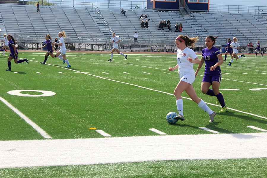 Sophomore Makenna Yoor sprints past a Waukegan defender in Tuesday's playoff opener.