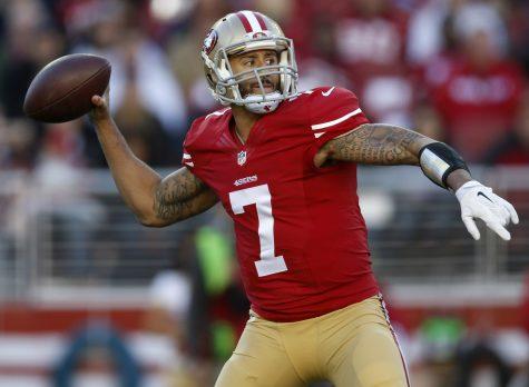 San Francisco 49ers starting quarterback Colin Kaepernick throws against the Arizona Cardinals on Dec. 28, 2014.