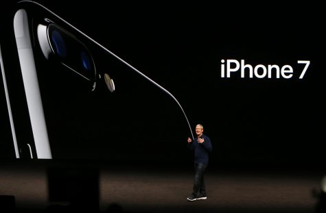 Apple CEO Tim Cook introduces the iPhone 7 on Sept. 7, 2016 in a San Francisco auditorium.