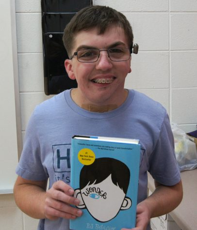 "Dankelson holds ""Wonder"", a book whose main character has a similar story to his own."