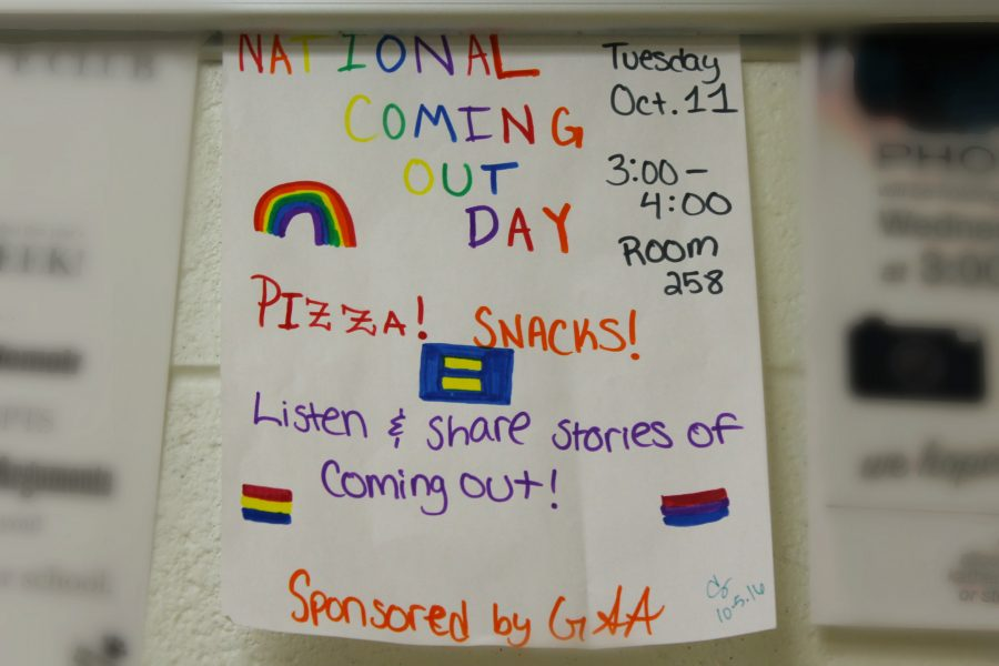 One of the many student-made posters that are hung throughout LHS to  publicizes GSA's National Coming Out Day meeting.