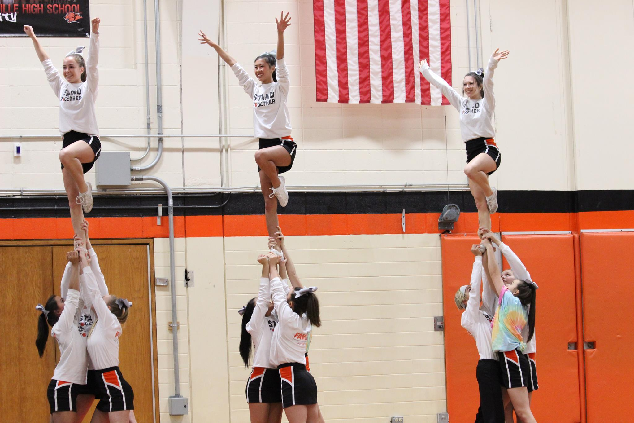During the boys basketball game vs. Lake Forest Academy, the Cheer team wore
