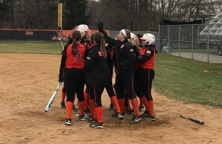 The+team+celebrates+as+Lyndsey+Lyon+hit+a+home+run+to+extended+their+lead+to+8-0.