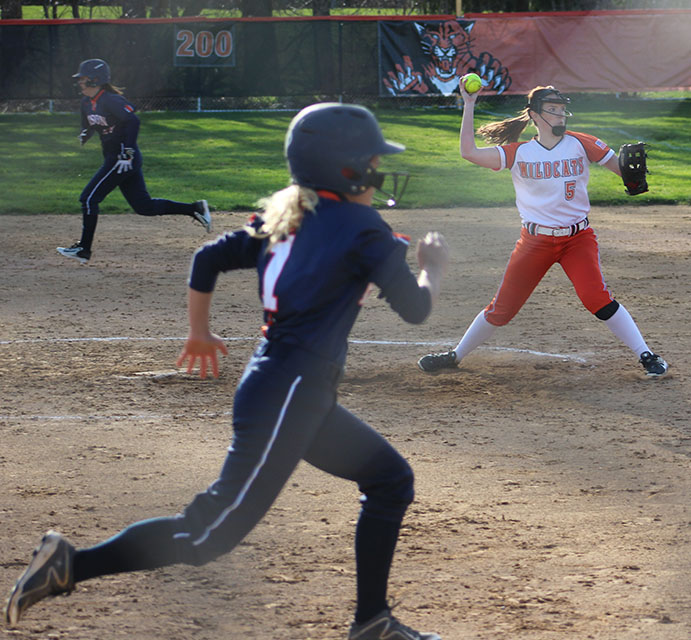 Heraty+throws+to+home+plate+for+the+out+against+Buffalo+Grove.
