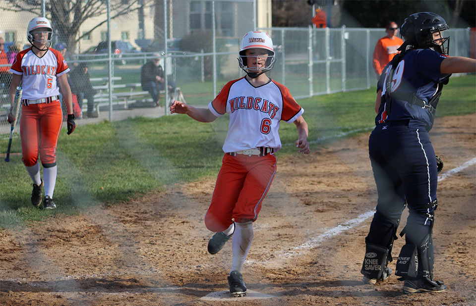+Lauren+Heraty+runs+into+home+plate+as+her+sister%2C+Hannah+Heraty+watches+while+on+deck.
