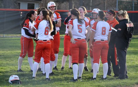 The team and their coaches celebrate and talk after their 11-1 win over Buffalo Grove.
