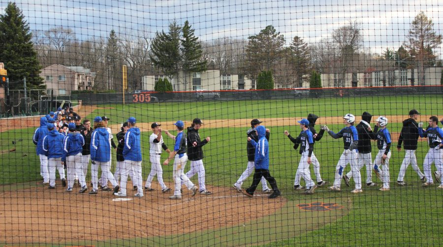 The+two+teams+shake+hands+after+Libertyville+defeated+the+Warren+Blue+Devils%2C+6-1.+Senior+Jack+Peterson+homered+for+the+Wildcats.
