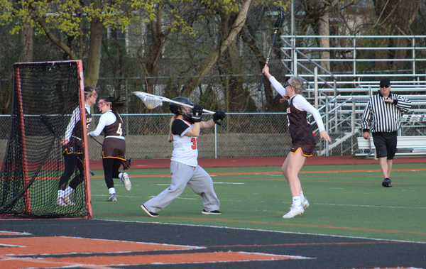 LHS+goalie+Natalie+Seitz+clears+the+ball+inside+of+the+crease+after+making+a+save.