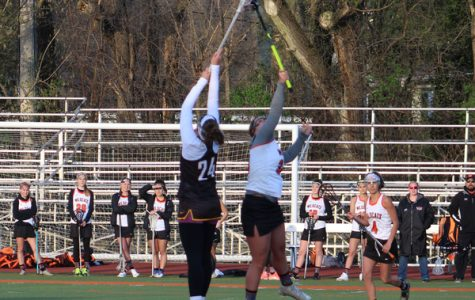 Freshman Emma Burns battles for the ball in the air after a draw.