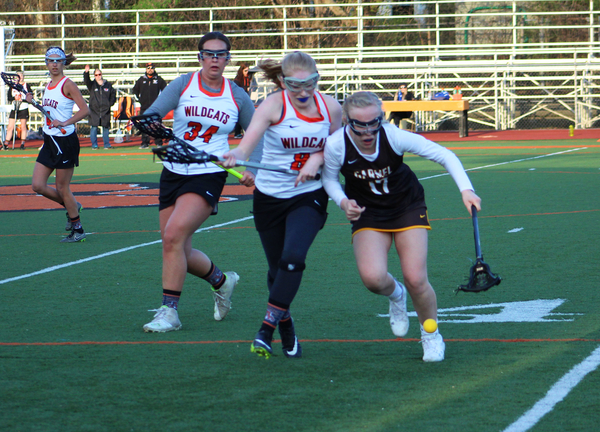 Junior+Marycate+Buchert+competes+to+win+the+ground+ball+against+an+opposing+Carmel+player.