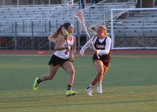 Abby+Meyer+drives+to+the+goal+while+cradling+the+ball.