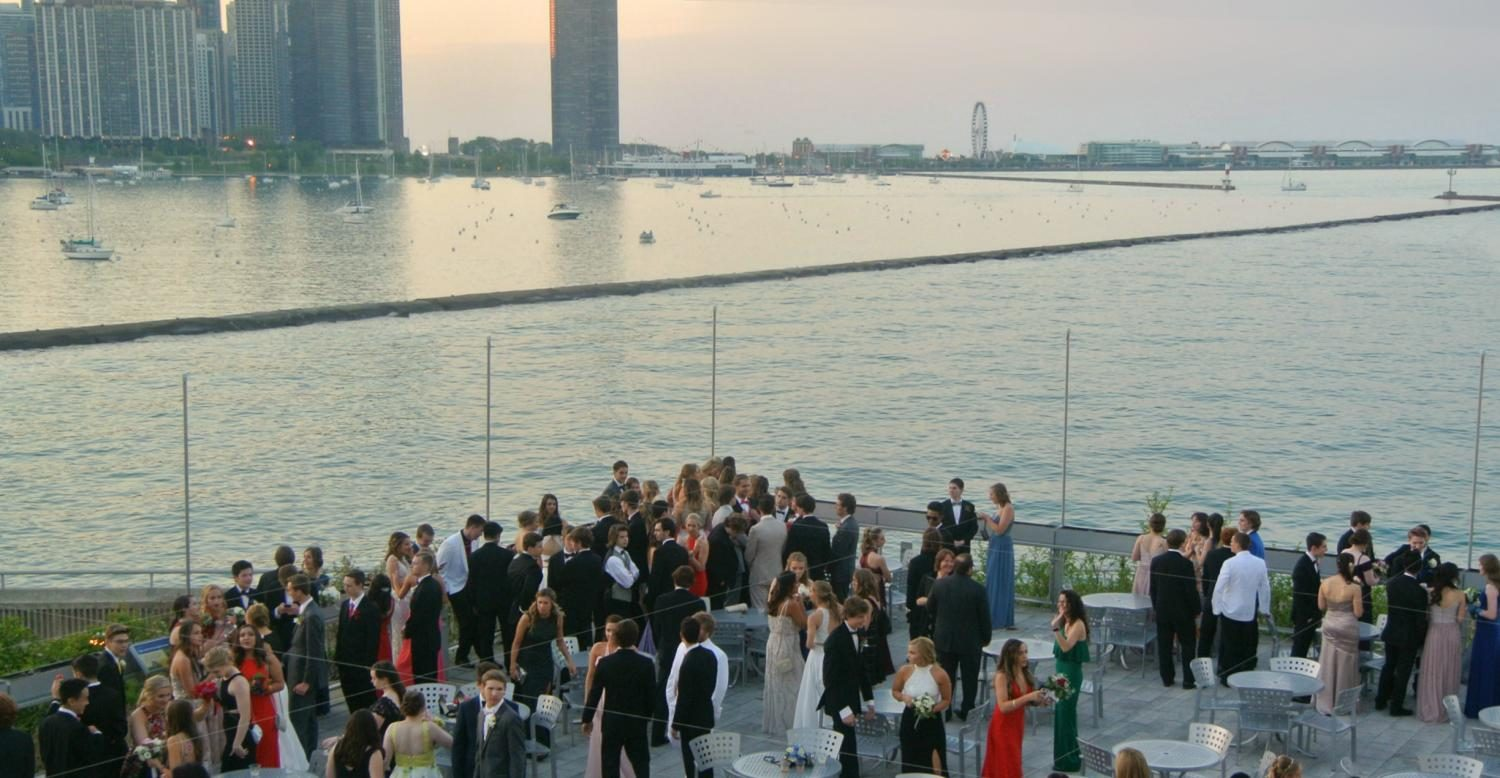 Before dinner, students and chaperones meet at the deck outside of the Shedd Aquarium to view the city skyline, chat and take pictures.