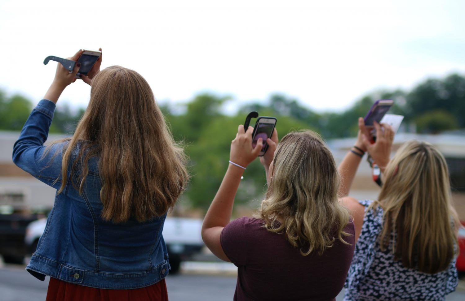 Others used their phones to view the eclipse, as it was not safe to look up with the naked eye, but it also was not visible at all times.