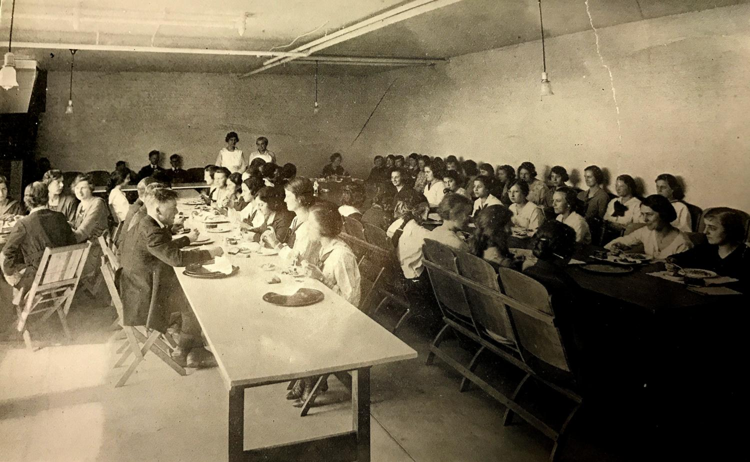 Students enjoy a meal in the basement of the Brainerd building, where the cafeteria was located.
