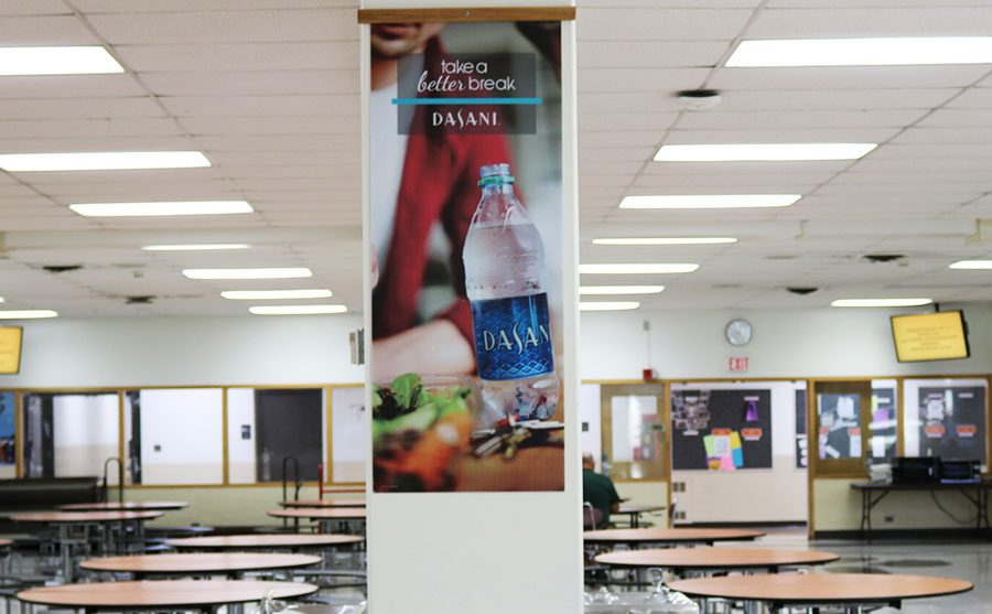 In+the+cafeteria%2C+students+can+find+two+Dasani+advertisements+on+columns.+