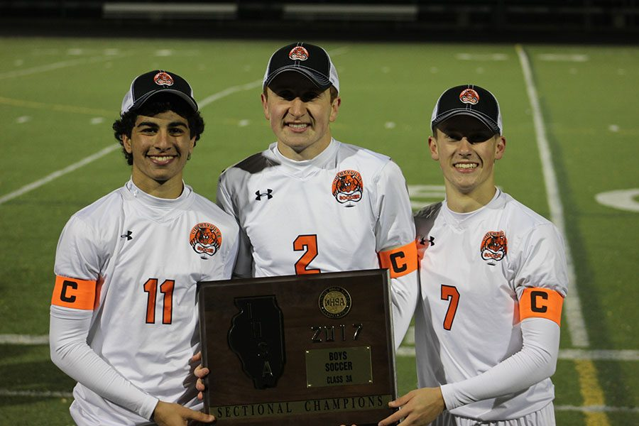 Senior captains (left to right) Greg Krikorian, Ryan Wittenbrink, and Riley Hoff with their hard-earned sectional plaque after their 8-1 win on Friday night at Fremd High School