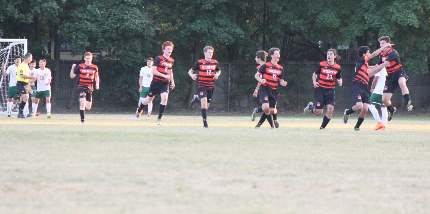 Libertyville players celebrate, after a goal by Greg Krokorian in the second half.