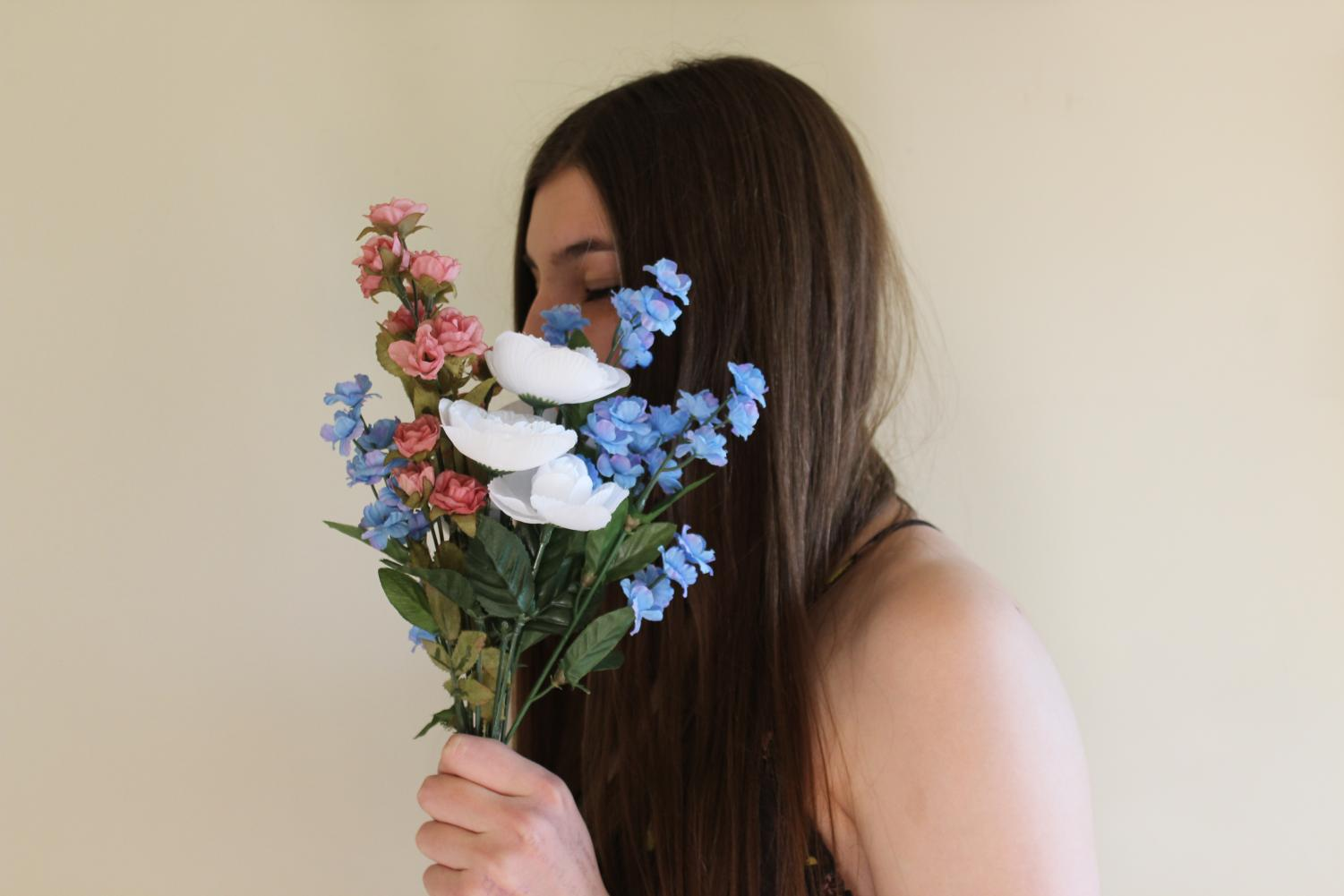 Tierney Keegan holds a bouquet of flowers resembling Ethereal Clothing Company's logo.