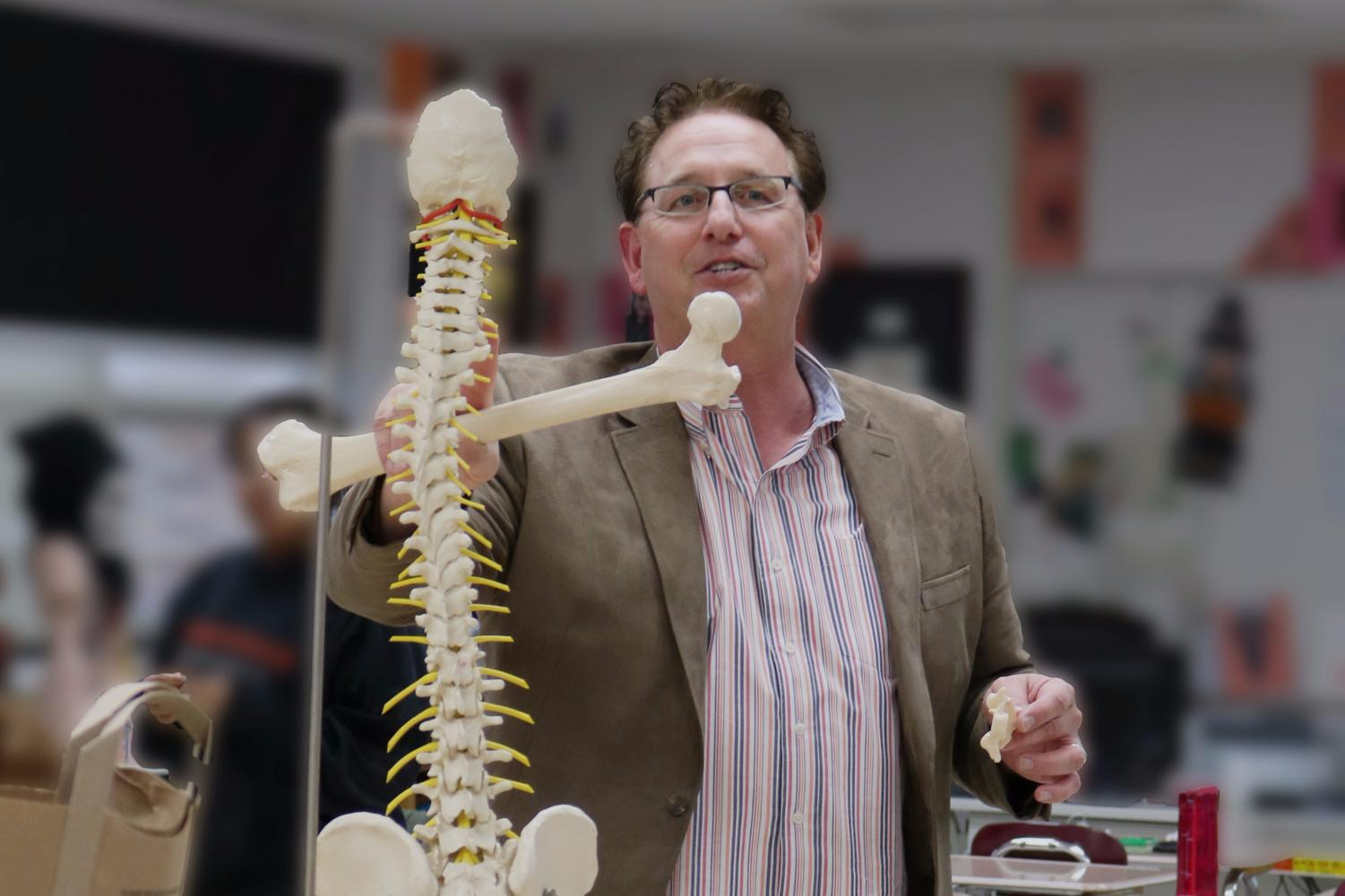 Mr. Kreutz uses models in his classes to indicate different parts of the spine.