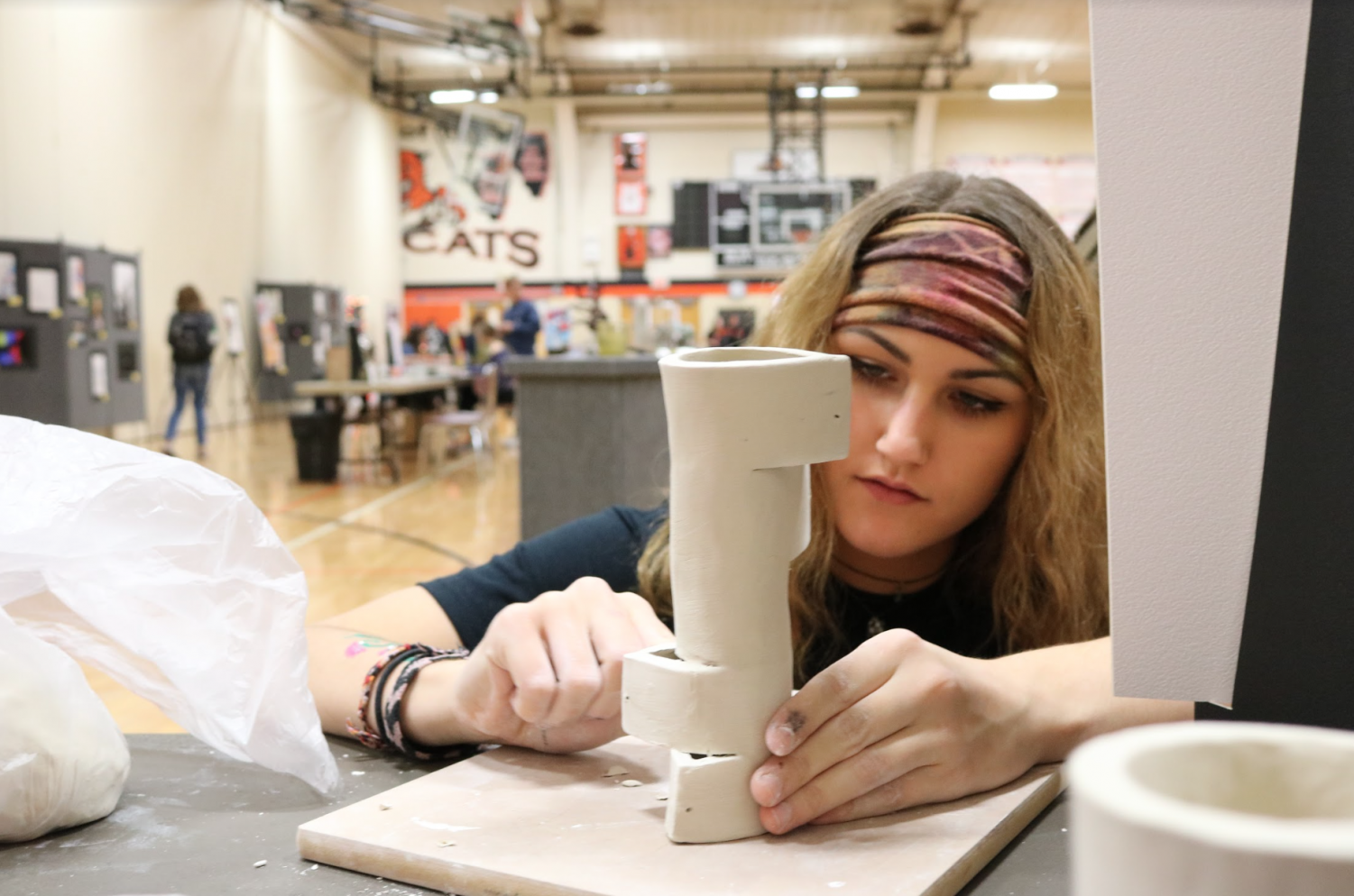 Junior Hannah Hartshorn works on a 3D piece for her concentration at the art show.