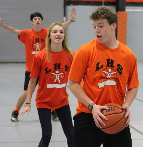 Freshmen Joey Neal, Claire Arnold and Dillion McDonald are just some of the freshmen participating in the basketball gym unit in Ms. Patti Mascia