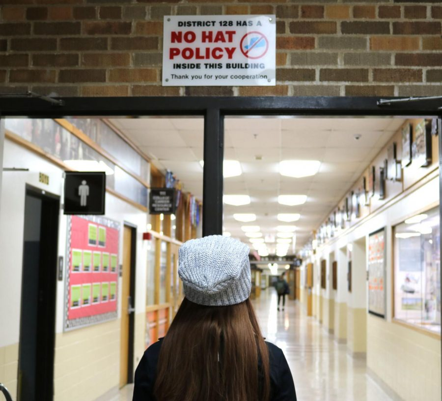 Despite+signs+around+the+school+and+current+school+policy%2C+senior+Megan+Wolter+and+other+students+are+still+able+to+wear+hats+to+school+and+in+the+hallways+without+getting+in+trouble.+%0A