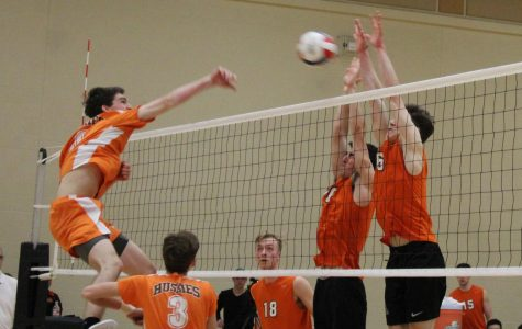 Varsity boys volleyball defeats Hersey