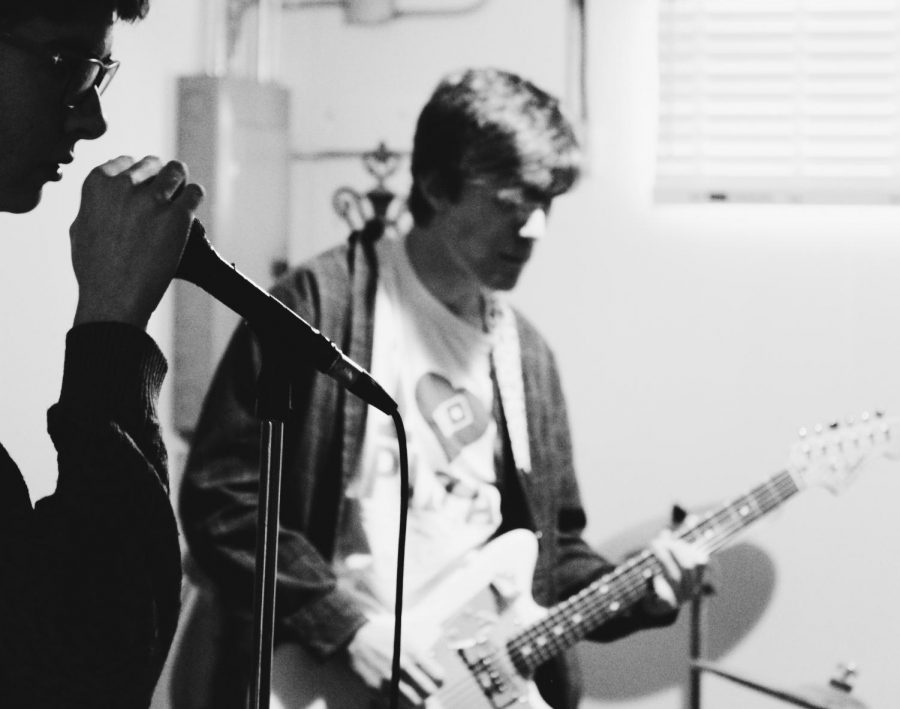 Both the band Poyo and Pt Cruiser often practice in the same space since they share band members. Senior Marty Brannaman (left) is the bass player for the band Poyo and sophomore Braeden Long is the lead guitarist for the band PT Cruiser.