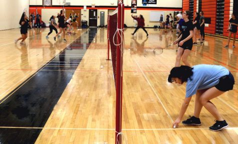 The LHS badminton team -- made up of exhibition, JV and varsity levels -- competes in doubles and singles matches, but all practice together in the Main Gym.