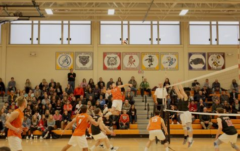 Senior Brendan Cook (23) jumps up for a spike at the end of the first set in which Libertyville won 25-23
