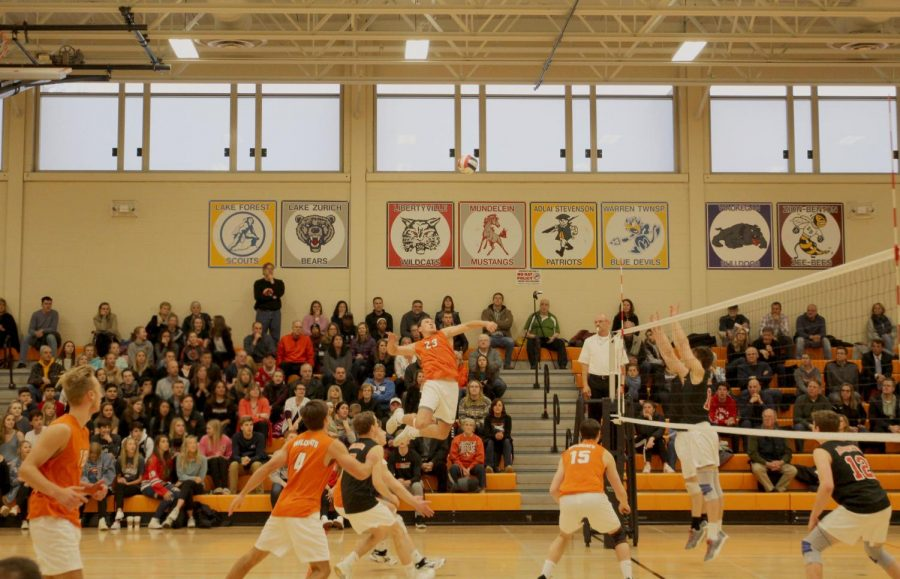 Senior+Brendan+Cook+%2823%29+jumps+up+for+a+spike+at+the+end+of+the+first+set+in+which+Libertyville+won+25-23