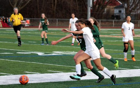Sophomore Victoria Villanueva tussles with a Stevenson defender for the ball.
