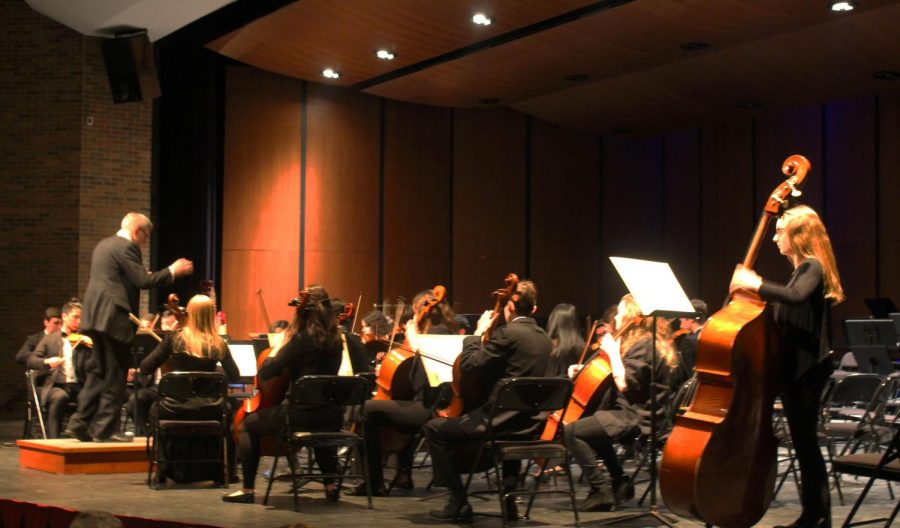"""The String Project orchestra played """"Take it All Back"""" by Judah and the Lion. The String Project Orchestra is an after-school club that plays popular, modern songs."""